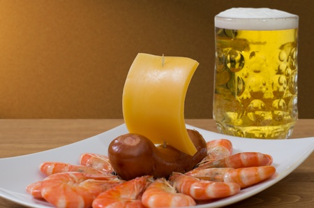 shrimp boat: A mug of beer, shrimp boat out of sausages and cheese Stock Photo