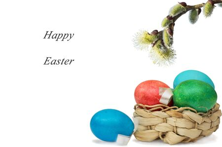 straw twig: Easter eggs in straw basket and blooming twig Stock Photo