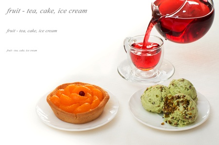 desserts with fruit and red tea on a white tablecloth