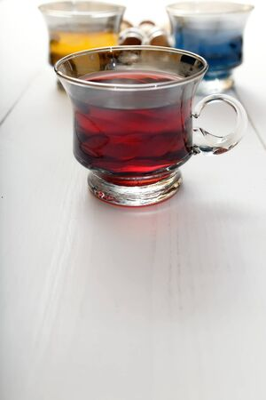 red tea: cup of red tea on a white table Stock Photo