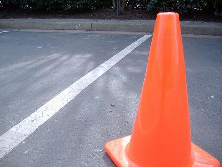orange cone in a parking lot