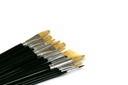 positioned: Set of painting brushes on white background, positioned diagonally Stock Photo