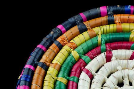 plaited: Colorful plaited Mexican straw basket detail isolated on black background