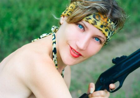 Young woman with gun on nature Stock Photo - 3930518