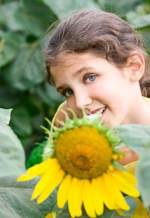 sunburned: Beauty teen girl and sunflower on nature
