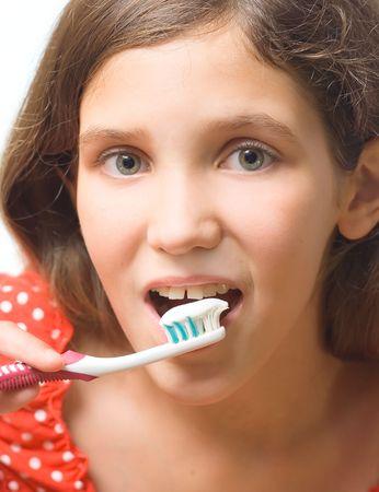 Beauty teen girl clean teeth isolated on white photo