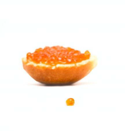Sandwich with red caviar isolated on white photo