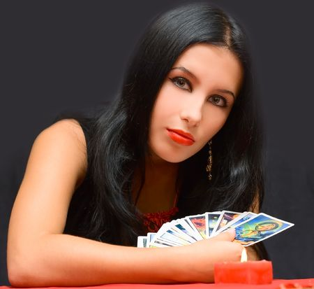 Portrait girl with cards on black background Stock Photo