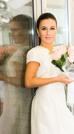 Young bride Girl and roses in cafe