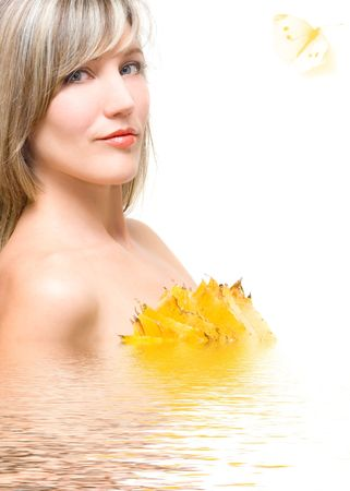 modesty: Portrait young woman in water isolated on white