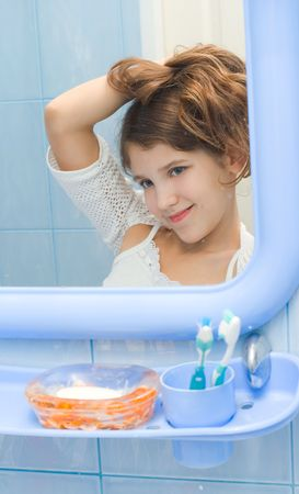 Teen girl in bathroom for your design photo