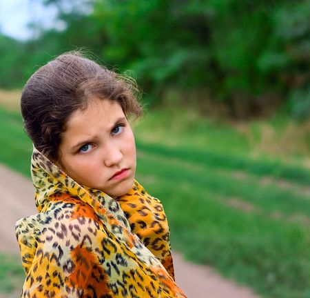 Sad teen girl outdoor on nature photo