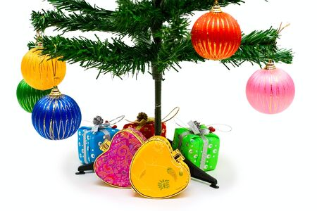 Holiday tree with decoration and gifts isolated on white photo
