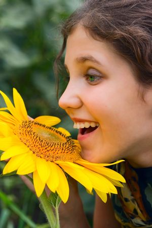 Beauty teen girl and sunflower on nature Stock Photo - 4924944