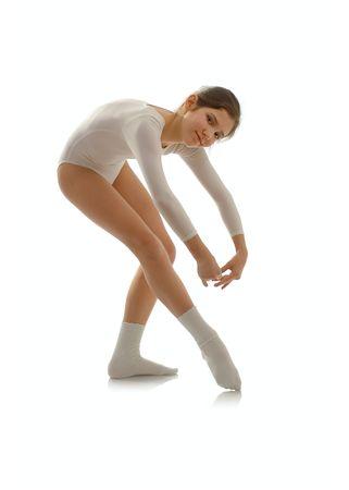 Portrait of cute teen ballet dancer girl isolated on white Stock Photo