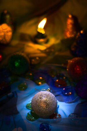 Holiday ball and candle background photo