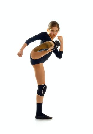 plimsoll: Portrait of cute teen gymnast girl isolated on white Stock Photo
