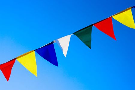 elated: Small flags on sky background