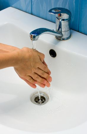 Washing hands in bathroom for your design photo