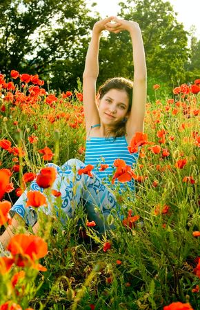 Portrait teen girl with poppy on nature photo