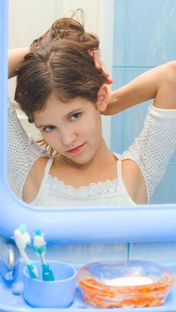 Pretty Teen girl in bathroom photo