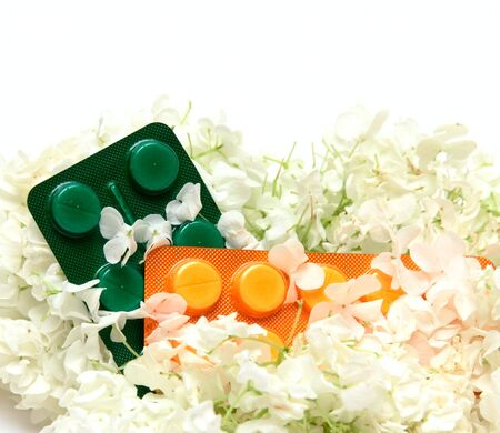 homoeopathic: Homoeopathic pills and white flowers