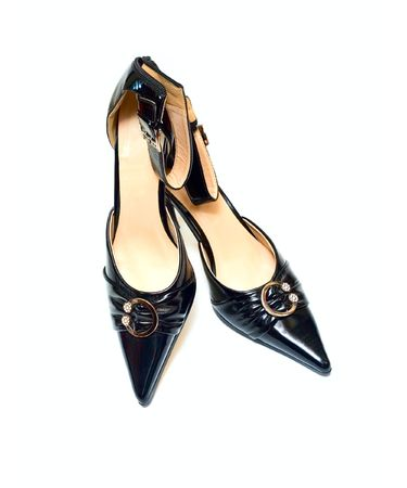 clasp feet: Black Female shoes isolated on white Stock Photo