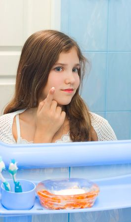 Teen girl in bathroom for your design photo