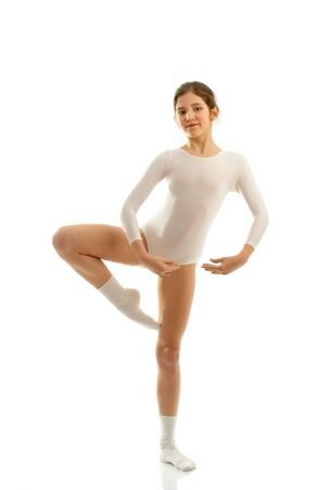 plimsoll: Portrait of cute teen ballet dancer girl isolated on white Stock Photo