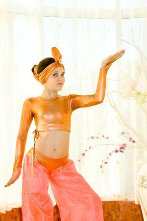 navel orange: Portrait of cute dance teen girl in east suit Stock Photo