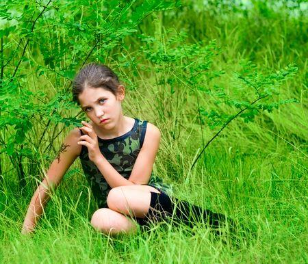 Beauty sad teen girl on nature