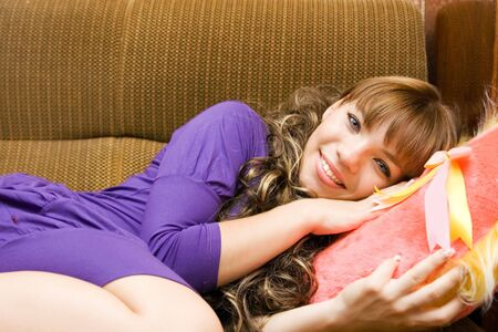 Portrait smile Girl and pink pillow photo