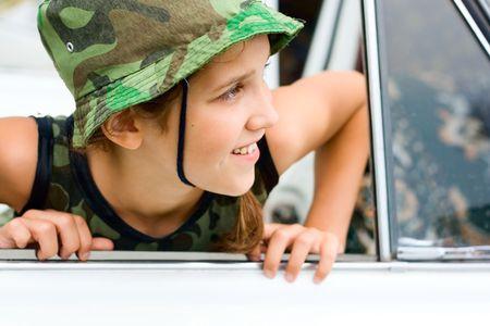 Lovely teen girl in white car Stock Photo