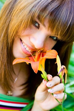 Portrait smile young girl with lily Stock Photo - 5785004
