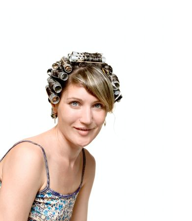 Young woman with haircurlers in her heir isolated on white Stock Photo - 5913058