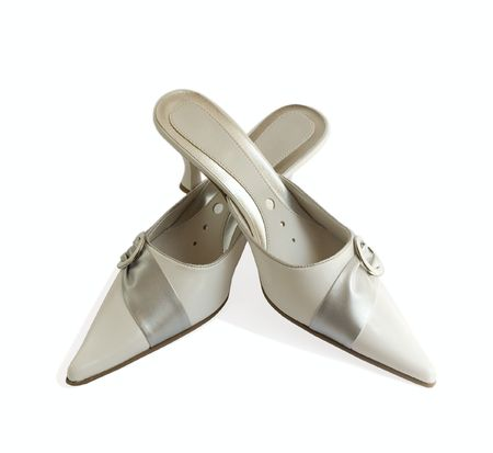 clasp feet: Female shoes isolated on white