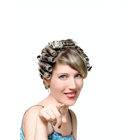 Young woman with haircurlers in her heir isolated on white Stock Photo - 6081672