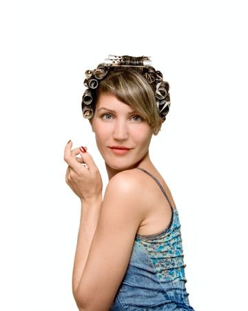 Young woman with haircurlers in her heir isolated on white Stock Photo - 6094746