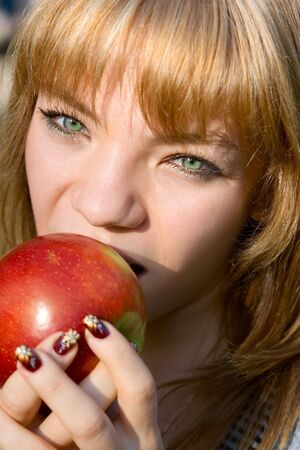 gnaw: Portrait young girl with apple