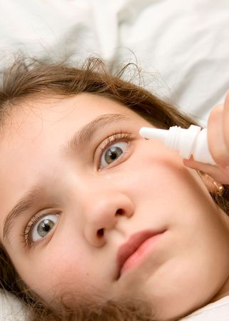 Portrait of cute teen girl with eye drops Stock Photo
