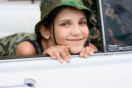 Lovely smile girl with hat in white car Stock Photo