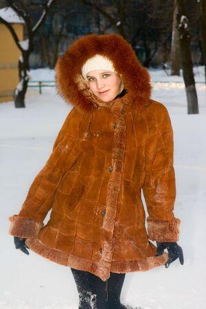 cute teen girl: Portrait of cute teen girl in sheepskin coat