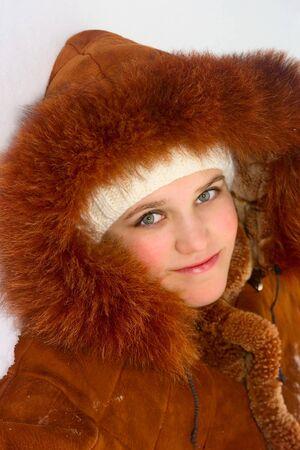 sheepskin: Portrait of cute teen girl in sheepskin coat