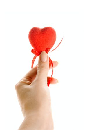 Red heart in human hand isolated on white photo