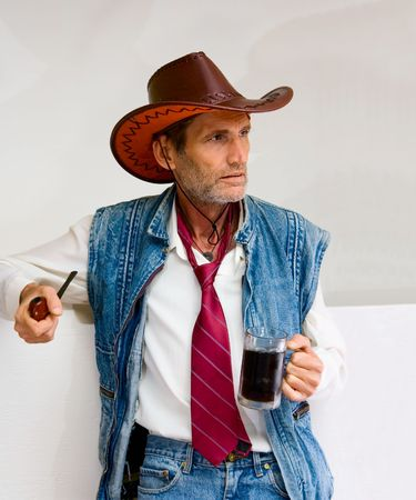 necktie beer: Old Man in cowboy hat with mug and pipe