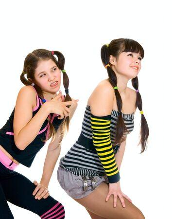 banter: Two fun teen girls isolated on white Stock Photo
