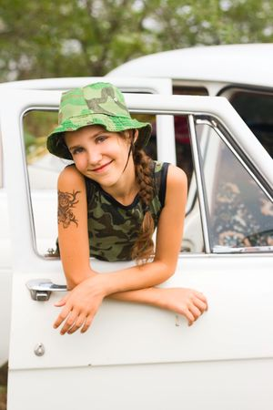 Teen girl in white car photo