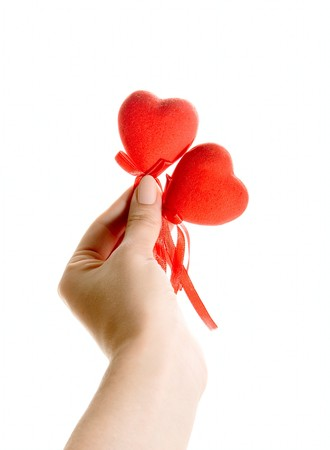 Red hearts in human hand isolated on white photo