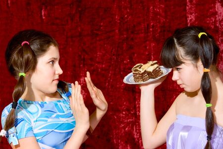 envious: Two Lovely teen girls with cake