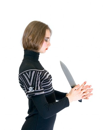 wicked problem: Lovely teen girl with knife isolated on white Stock Photo